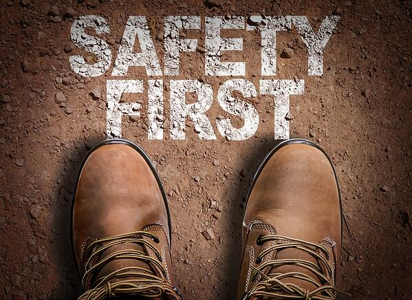 Top View of Boot on the trail with the text Safety First-1