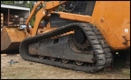 undercarriage of a Case 450 track loader
